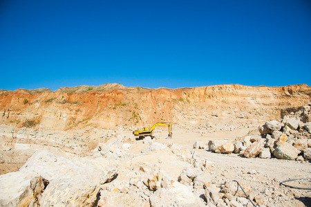Mining, quarrying, and production of stone at a forsaken quarry Stock Photo