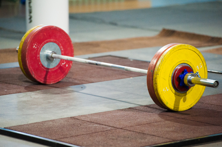 Weightlifting Barbell loaded with heavyweights ready for a class or competition to begin Stock Photo