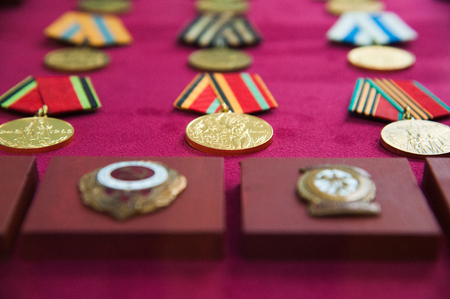 Old retro and modern military orders and military medals on red background Stok Fotoğraf