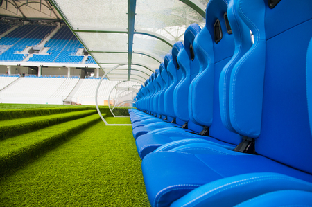 View of blue bench or seat or chair of staff coach in the stadium of football