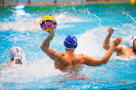 Water polo action in a swimming pool 免版税图像