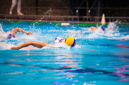 Water polo action in a swimming pool Stock Photo