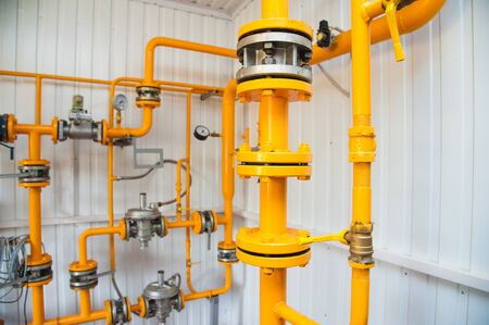 Modern boiler room equipment for heating system. Pipelines, water pump, valves, manometers