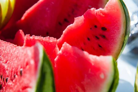 Slices of red ripe watermelon and yellow melon. Fresh fruit Stok Fotoğraf