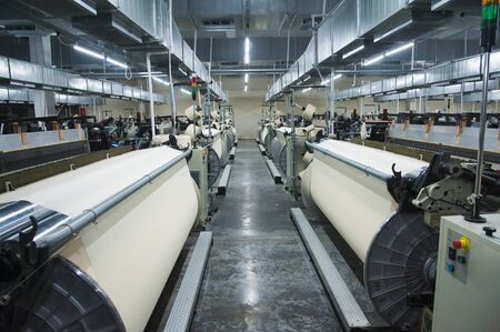 Industrial fabric production line. Weaving looms at a textile factory Reklamní fotografie