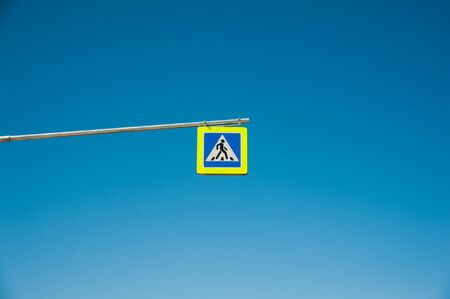 Road sign against the sky: pedestrian crossing Stock Photo
