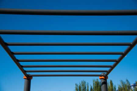 Outdoor gym for street workout. Modern outdoor gym in the residential area. Sports ground.