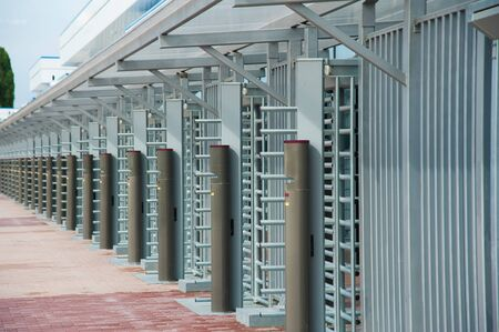 Protected entrance gate - secured turnstiles outdoors at stadium Stock Photo