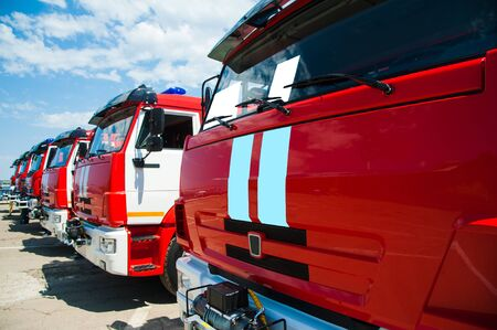 Car pool with fire engines of fire department Stockfoto