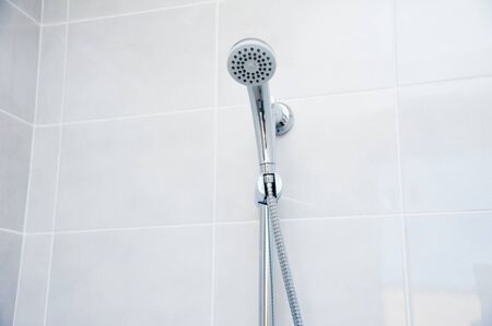 Showers in a public shower with tiles and lighting. Common showers in the fitness room or pool Reklamní fotografie