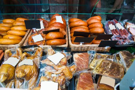 Selection of sausages at a butchers counter or delicatessen window Stok Fotoğraf