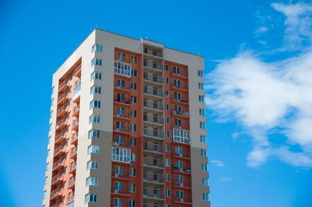 Brand new apartment building against the blue summer sky