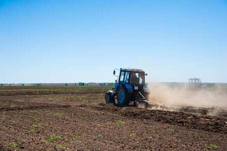 Tractor plowing fields - preparing land for sowing