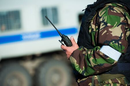 Russian special forces soldiers with weapon take part in military maneuver. War, army, technology and people concept