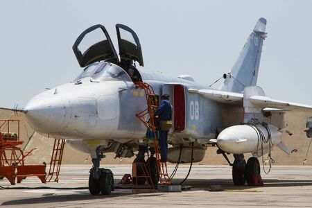 Military fighter jet at the airfield. Service before flight