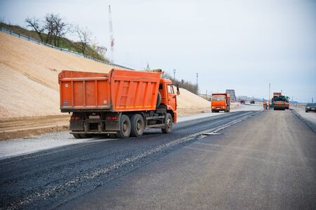 The road rollers working on the new road construction site