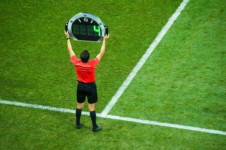 Technical referee shows 3 minutes added time during the football match Foto de archivo