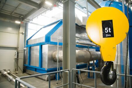 Grain processing facility inside. Industrial factory silos and equipment for food production