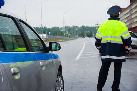 Road patrol service. Traffic cop on the road
