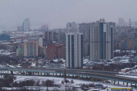 Panoramic view of the city on a cloudy winter day