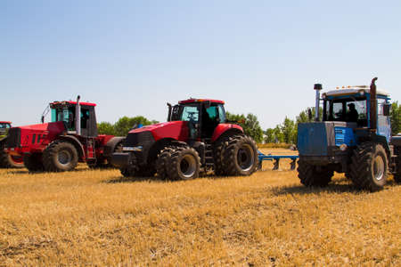 Agricultural tractor plowing a field before sowing