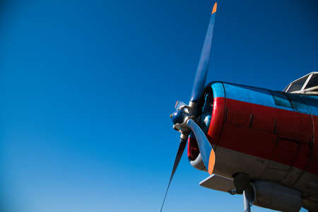 Small aircraft against the blue sky. Flight of an agricultural aviation aircraft