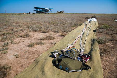 Parachutes are laid out on the ground before a skydiving competition. Parachuting