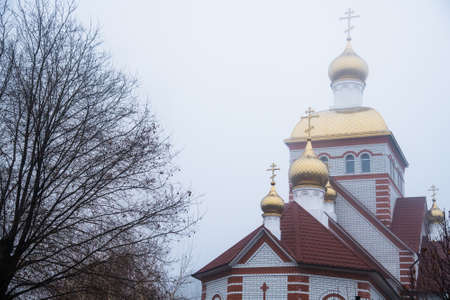 Orthodox Church on the background of the autumn sky. Religion