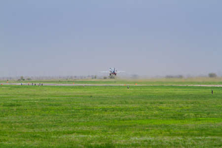 Military fighter takes off at the airfield 免版税图像