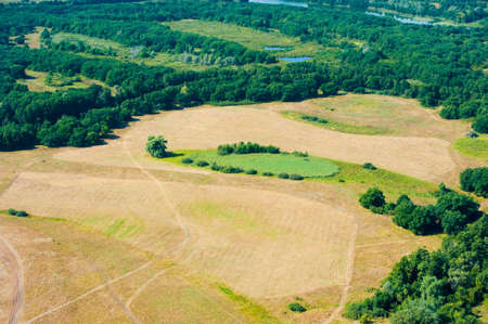 Aerial view of fields and meadows during a summer day