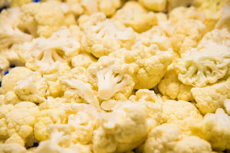 Cauliflower is cleaned, washed, dried and frozen for further storage. Industrial line for processing and storage of vegetables.