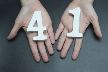 Female hand with number forty-one. Banco de Imagens