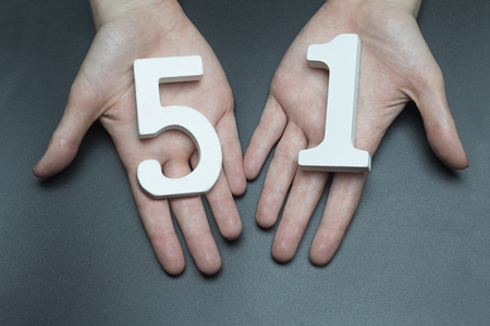 Female hand with number fifty-one. Banco de Imagens