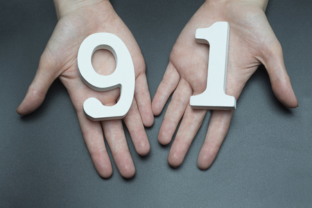 Female hand with numbers ninety-one.