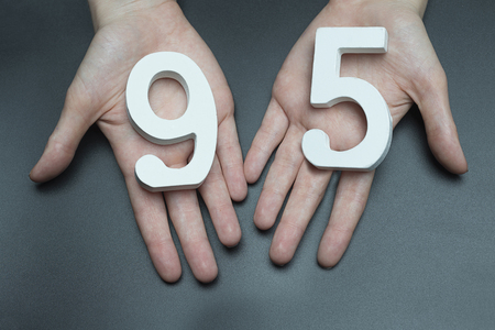 Female hand with numbers ninety-five.