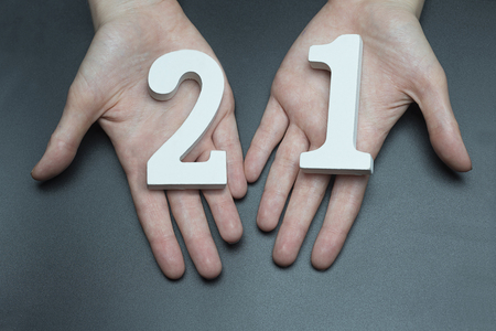 Female hand with number twenty-one. Imagens