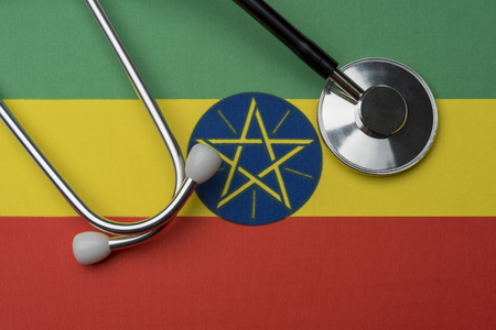 Ethiopia flag and stethoscope. Stethoscope on the flag as a background.