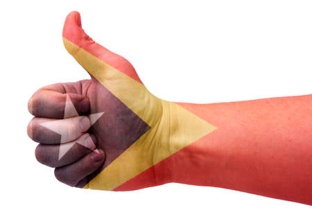The East Timor hand concept gives the thumbs up with the flag of Saint Lucia. Hand and flag of Saint Lucia.