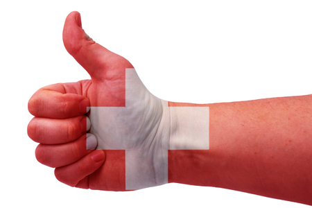 The concept of the hand gives a thumbs up with the flag of Switzerland.