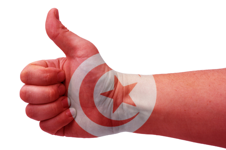 The concept of the hand gives a thumbs up with the flag of Tunisia.