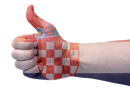 The concept hand gives a thumbs up with the flag of Croatia.