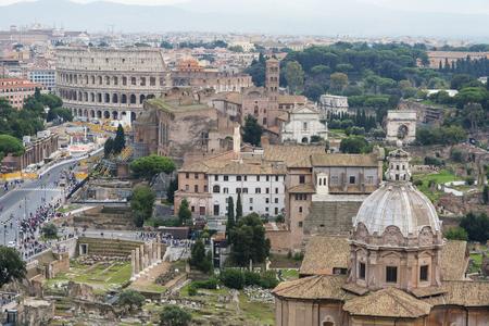 Aerial scenic view of Colosseum, Roman Forum in Rome and church of Santi Luca e Martina, Italy.