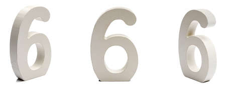 Number six on a white  at different angles.