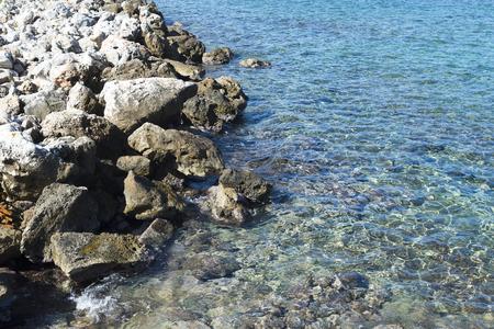 The sea waves splashes on a stony beach 版權商用圖片