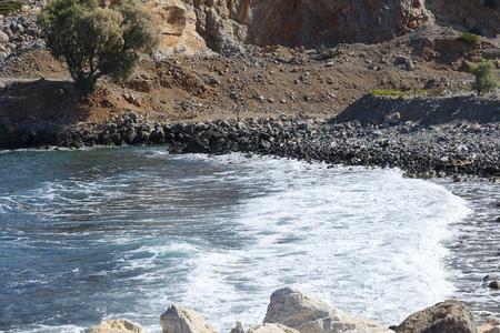 The waves splashing on a stony beach