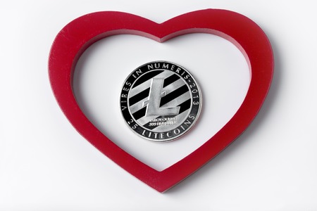 Litecoin with heart shaped design isolated on white background