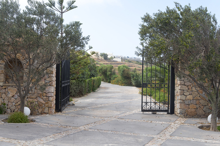 Park entry with open wrought-iron gate