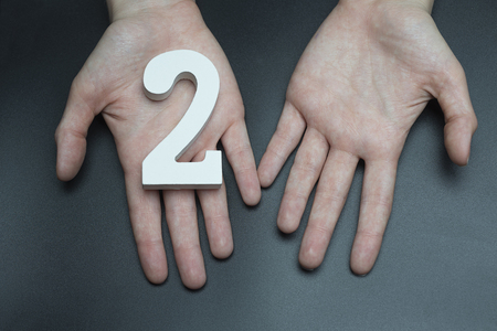 Female hand with number two. Imagens