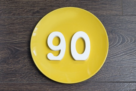 Figure ninety on the yellow plate and brown background.