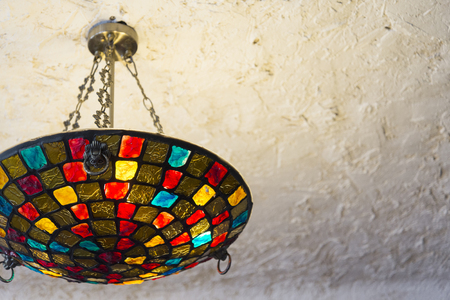 Colorful Modern Chandelier Hung on White Ceiling Фото со стока